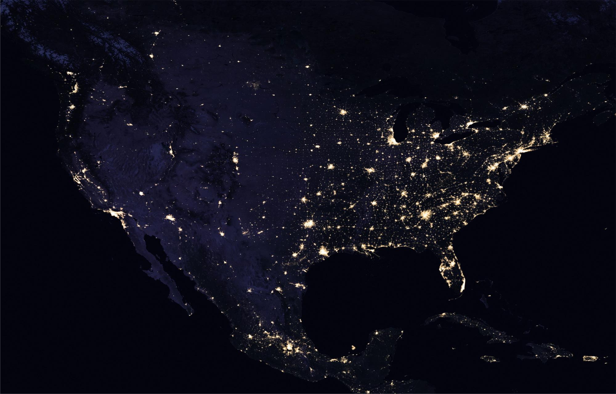 <h5>América do Norte</h5><p>Vista da América do Norte à noite. Fonte: NASA</p>